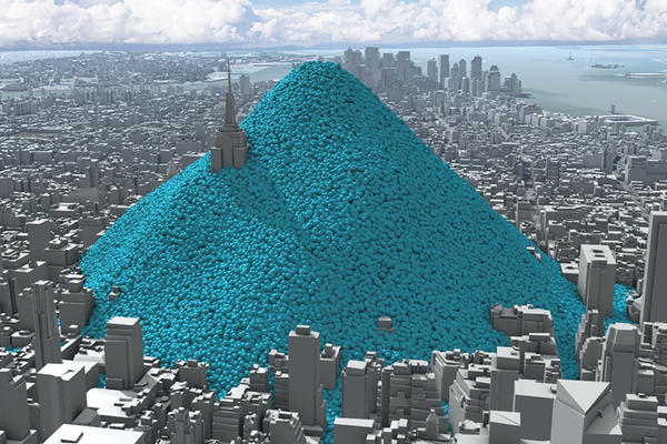 Visualisation of New York City's daily carbon dioxide emissions as a heap of one tonne blue spheres heaped up on Manhattan island. Image by Carbon Visuals on Flickr (CC BY).